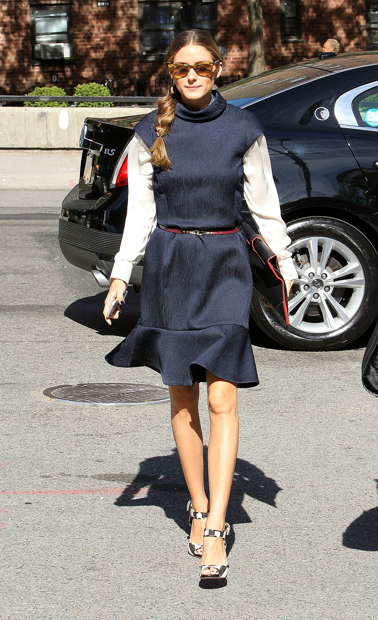 We love the back-to-school vibe to this fit-and-flare dress she layered with a white top.