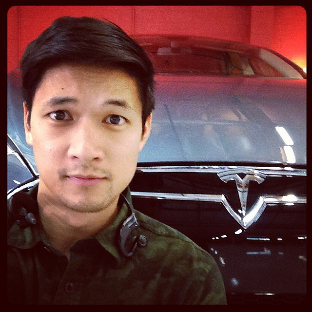 "Harry Shum Jr. posted a photo while getting ""photobombed by a wild grey Tesla."" Source: Instagram user harryshum"