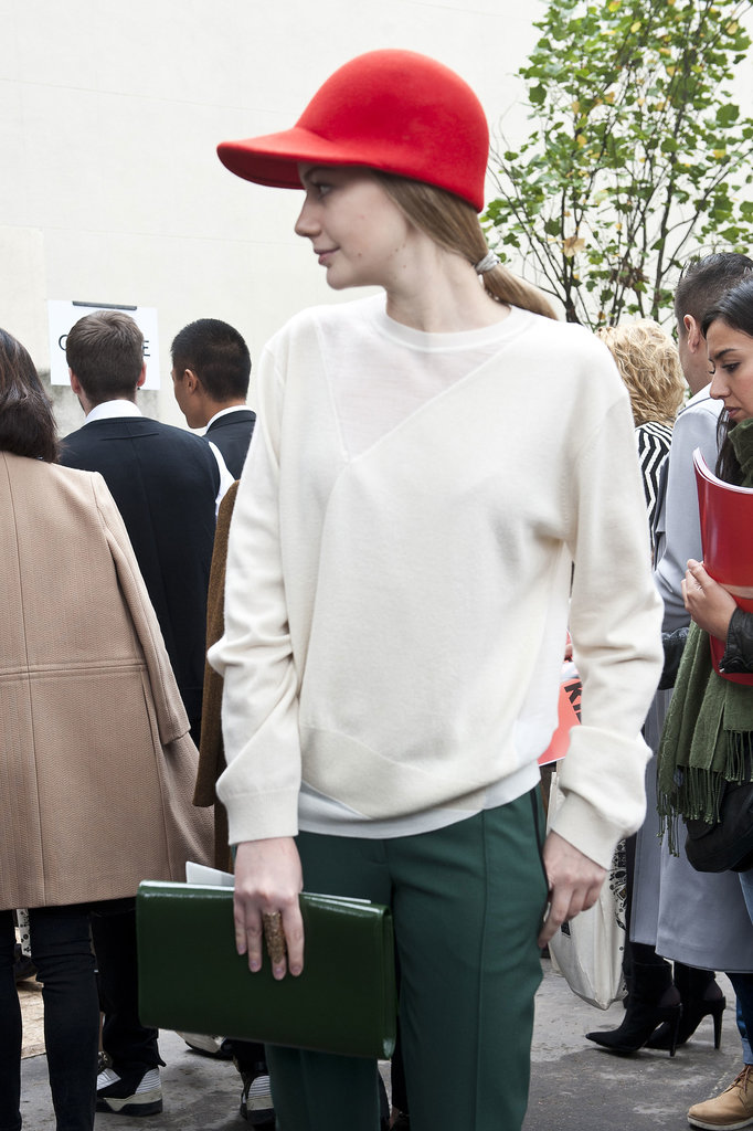 Making a statement in a red cap and a touch of green.