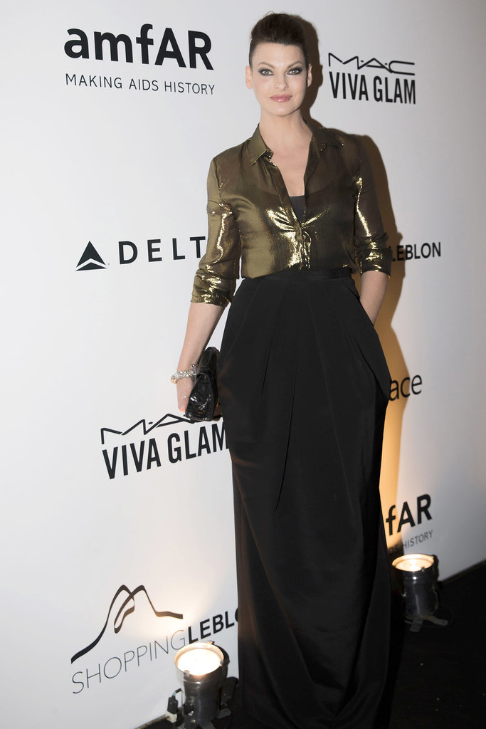 Linda Evangelista glowed at Rio's amfAR Inspiration Gala in a bronze and black ensemble.