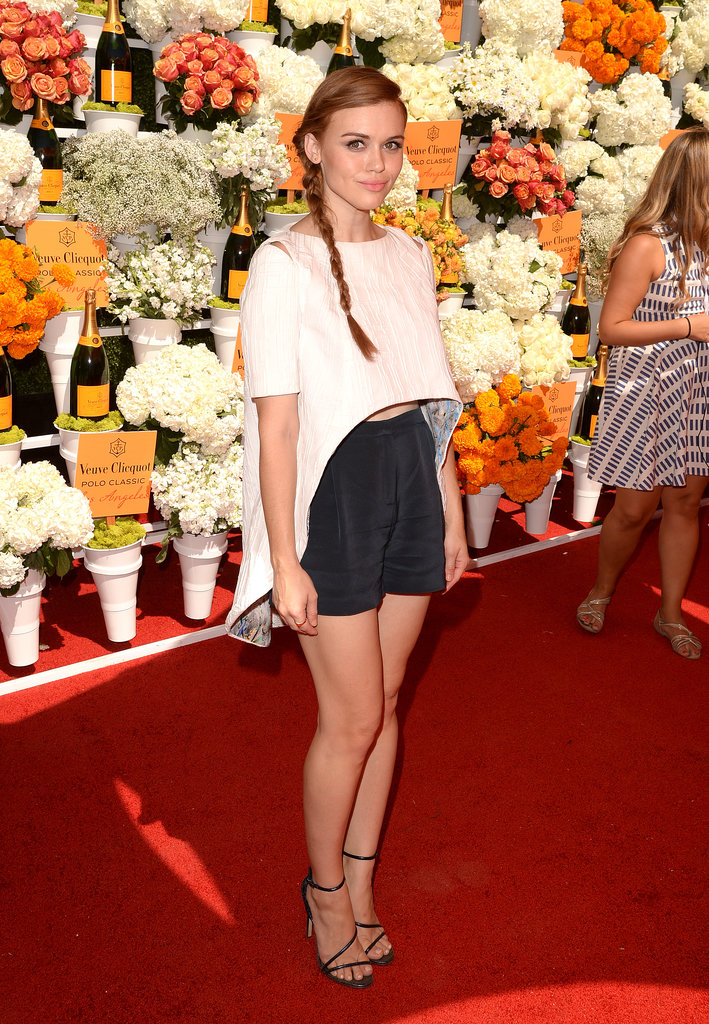 Holland Roden paired a white high-low blouse with navy silky shorts — both by Chistian Cota — and strappy B Brian Atwood sandals at the fourth annual Veuve Clicquot Polo Classic.