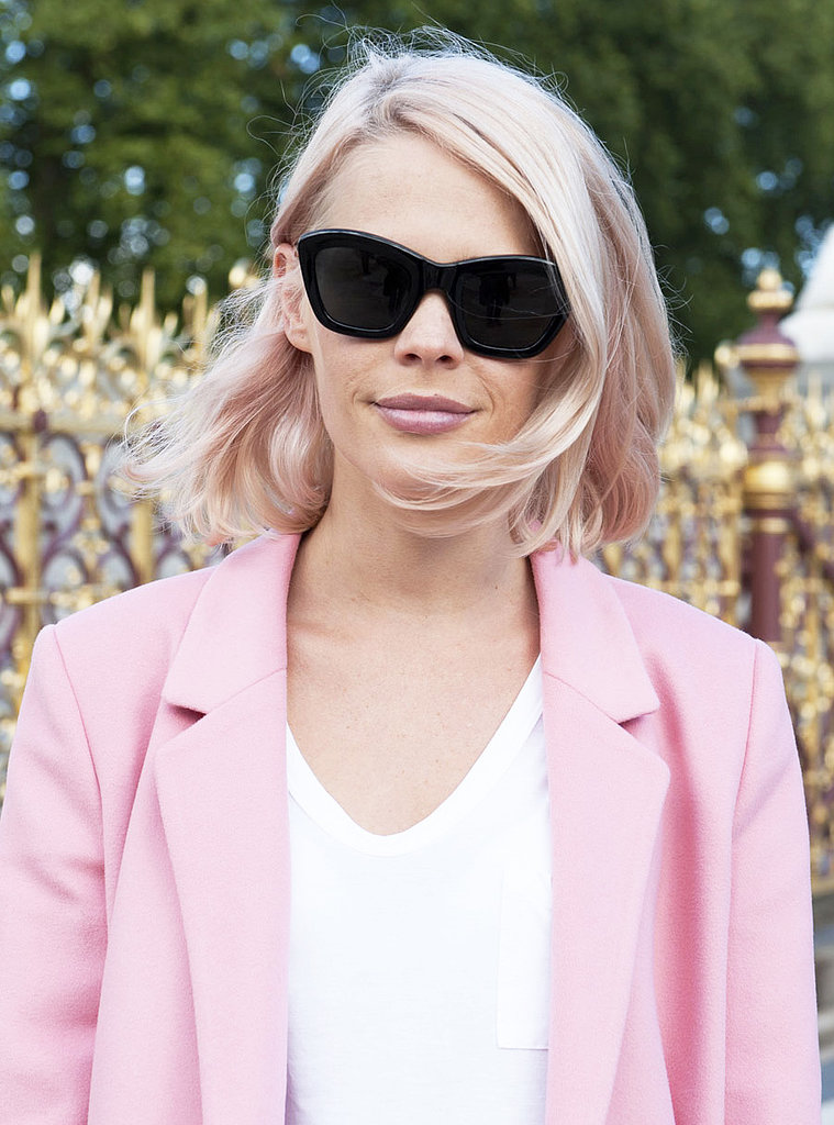 Pink coats are in for Fall, and we love how this girl matched her hair and lips to the look.