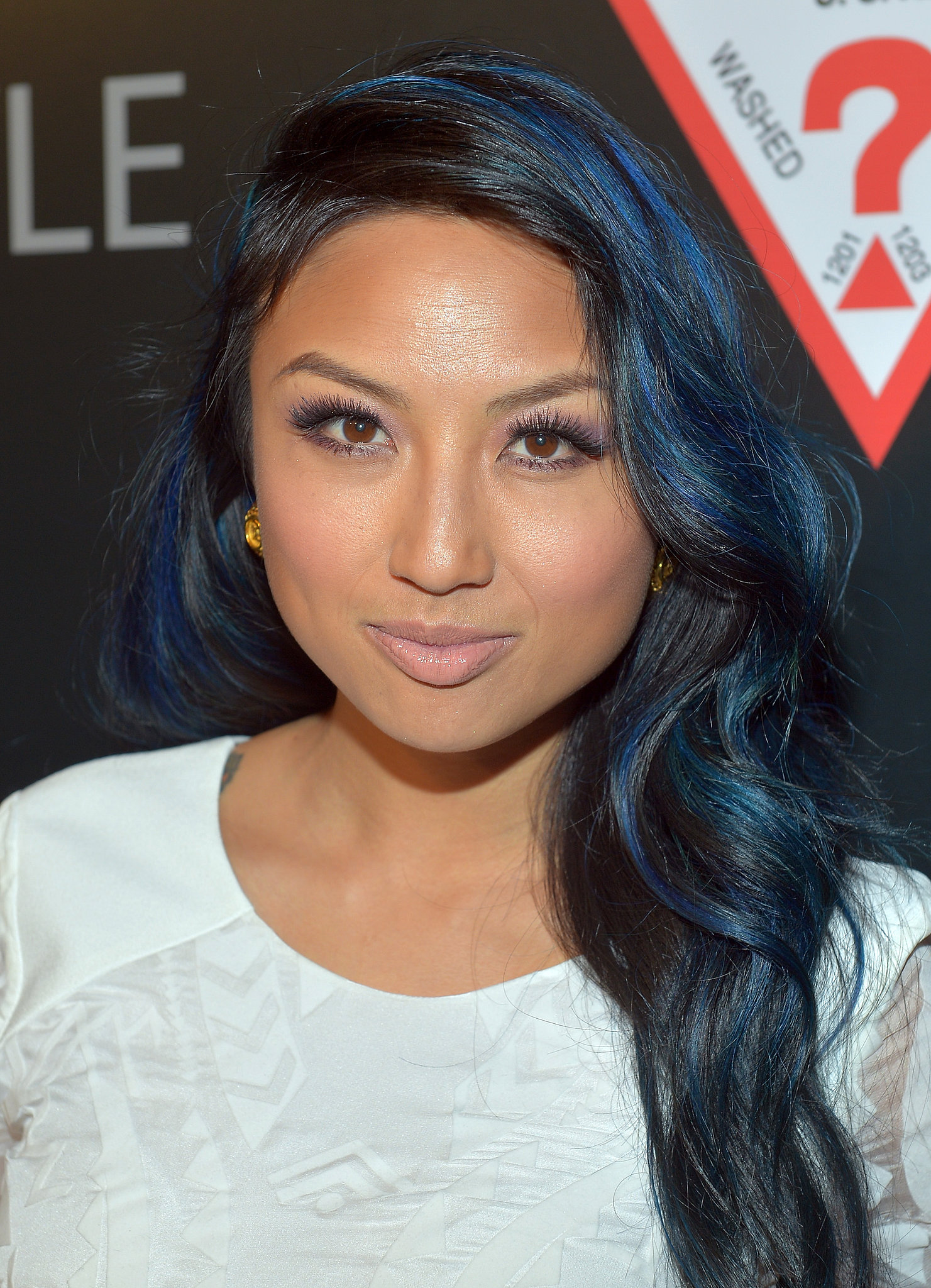 Jeannie Mai livened up her raven hair with dark blue and green streaks    Jeannie Mai Hair