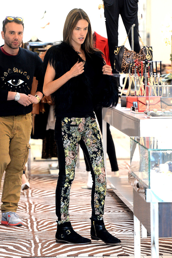 Alessandra Ambrosio tries on a Michael Kors vest while shopping in LA.
