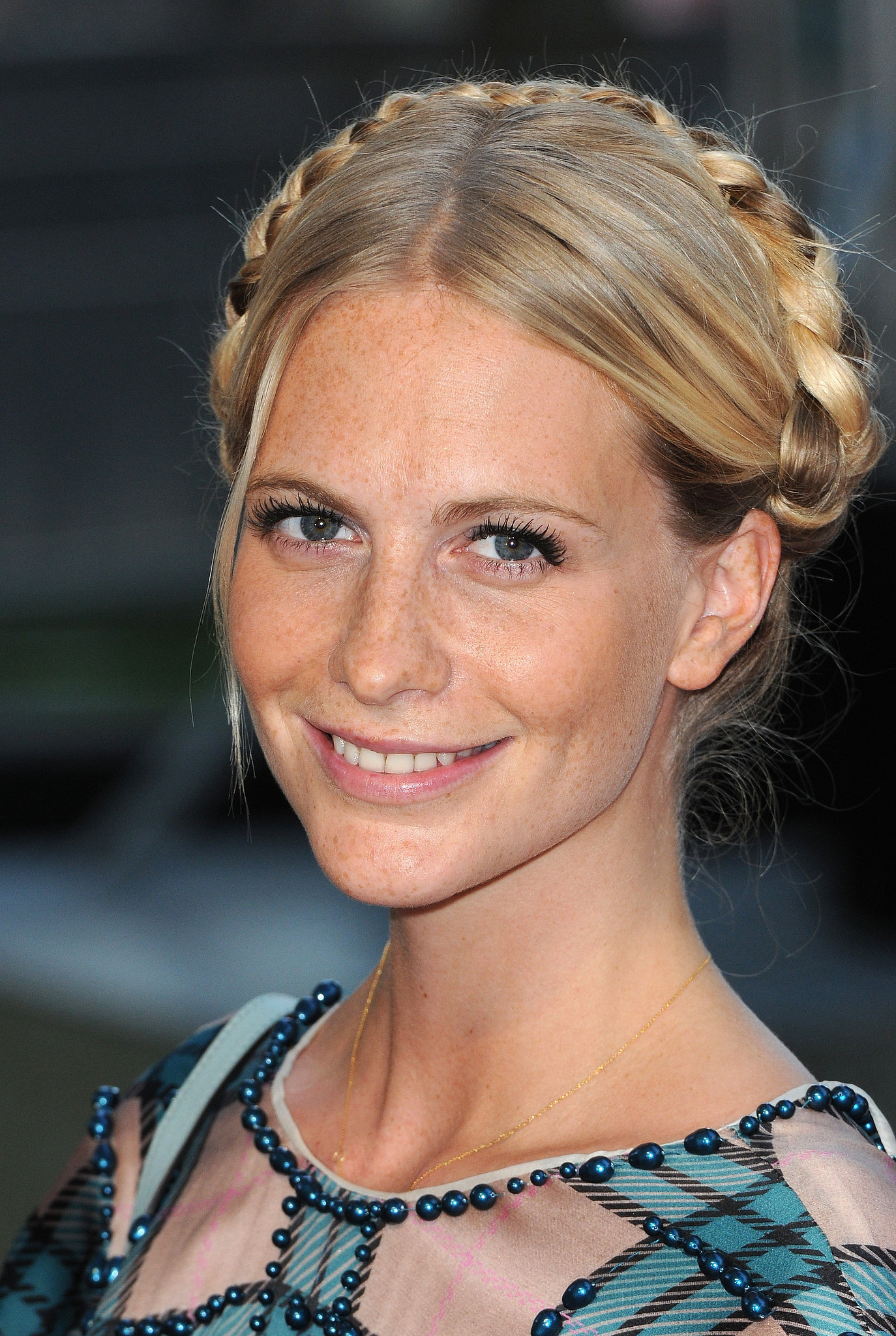 Poppy Delevingne opted to keep her milkmaid braids smooth and sleek.