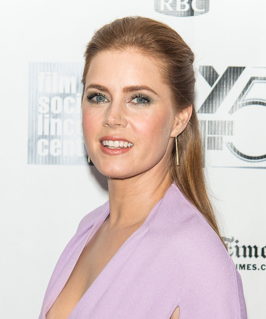 Wearing a low-cut frock, half-up hairstyle, and metallic smoky eye, Amy Adams amped up the glam factor at the Her premiere