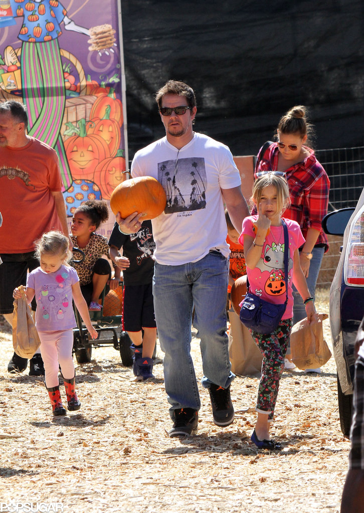 Mark Wahlberg walked through a pumpkin patch with his kids.