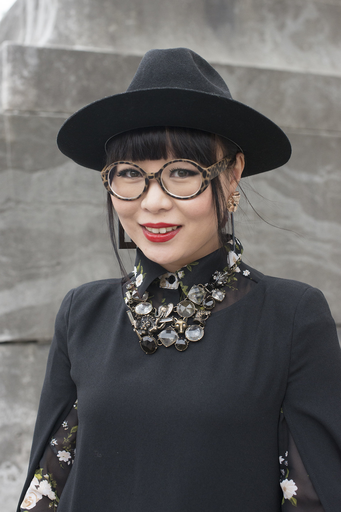 Blunt bangs look especially gorgeous under a brimmed cap.