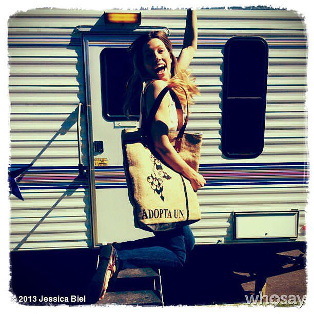 Jessica Biel jumped for joy while showing off the bag she designed for BareMade. Source: Jessica Biel on WhoSay