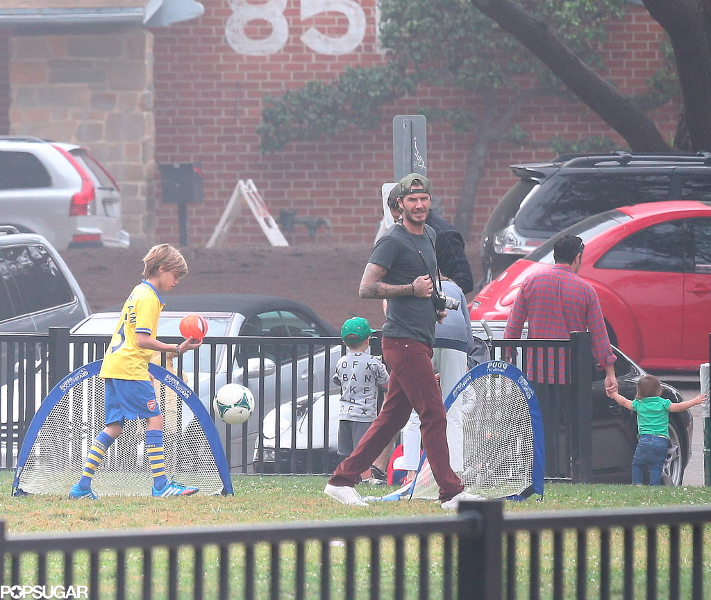 David Beckham played a little soccer on the sidelines with his sons.