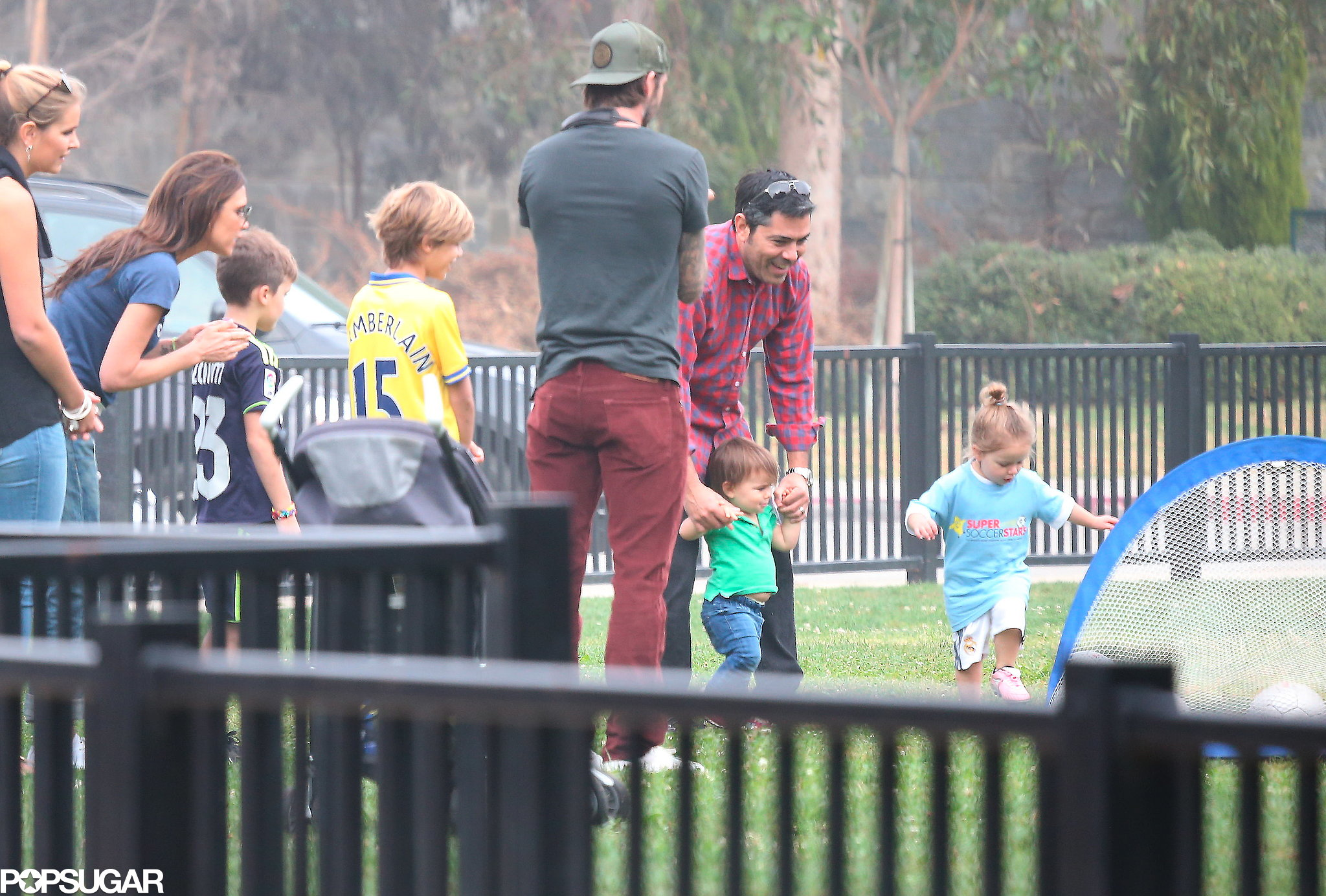 Harper Beckham played soccer while her parents, David Beckham and Victoria Beckham, looked on.