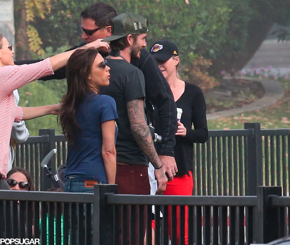 David Beckham and Victoria Beckham stood on the sidelines while little Harper played soccer.