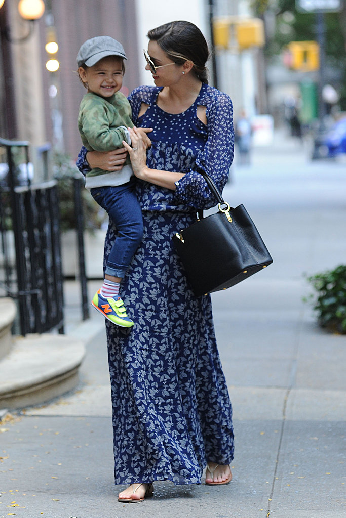 Miranda took Flynn (and her Capucines bag!) out again for a spin, this time in a blue printed maxi dress and sandals.