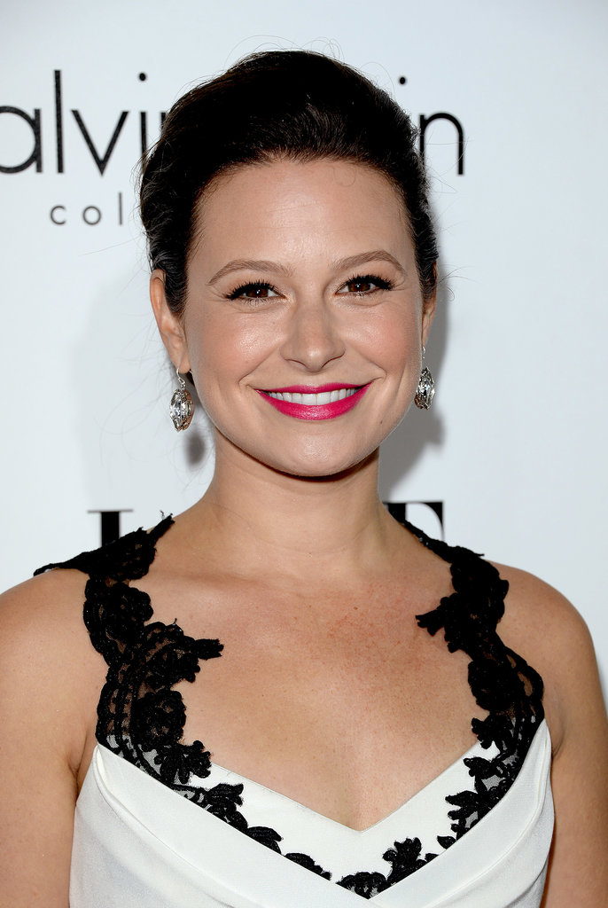 Scandal star Katie Lowes added a pop of color to her black-and-white ensemble with a hot pink lipstick hue with Tarte Glamazon Pure Lipstick in Foxy ($26).