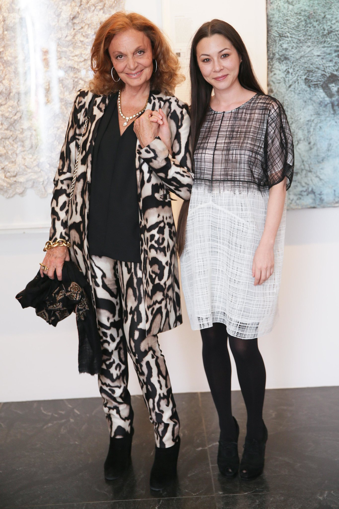 China Chow joined Diane von Furstenberg at amfAR's Two x Two Young Collectors preview in coordinating color palettes.