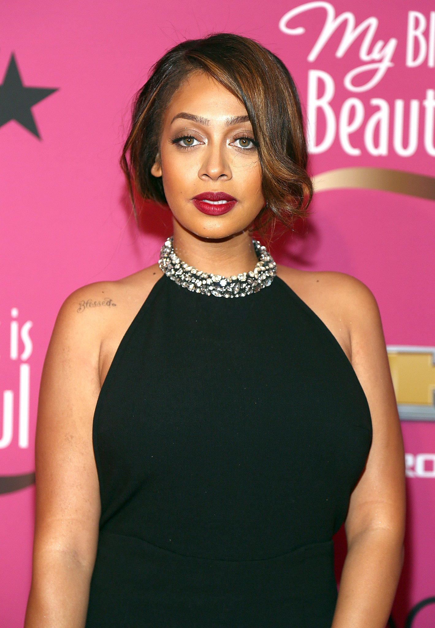 We loved this faux bob and red lipstick on LaLa Anthony for a retro vibe.
