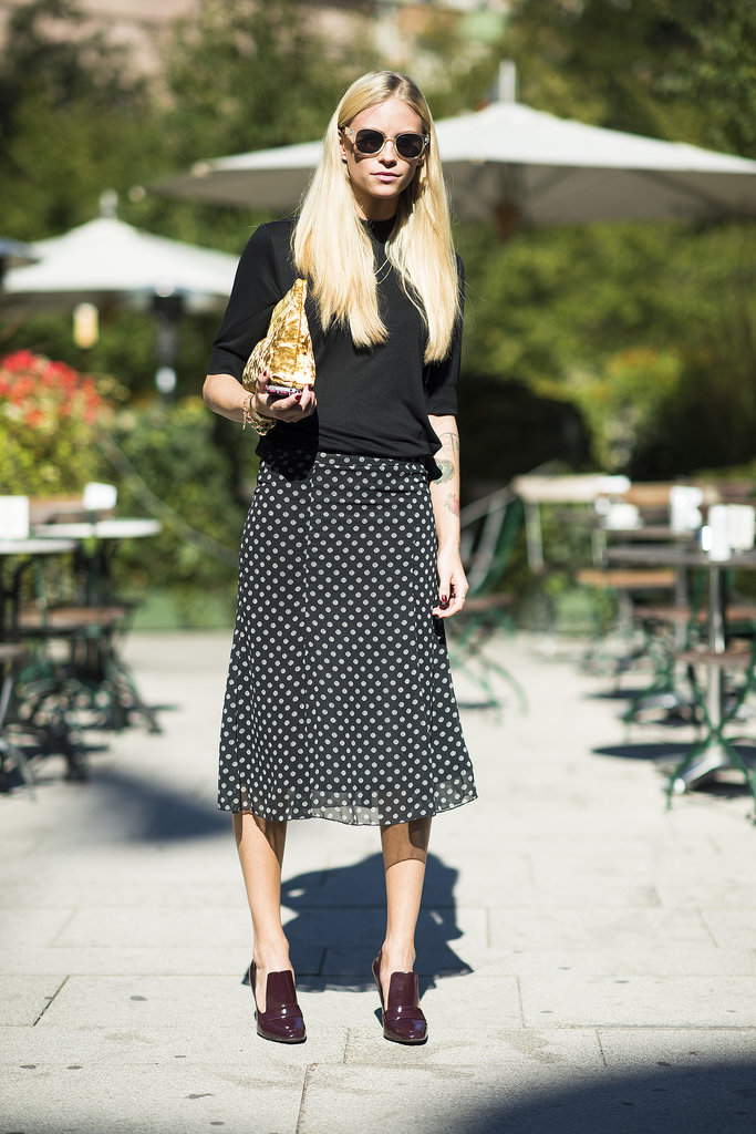 Play it one part casual, one part sophisticated with a relaxed tee up top and a ladylike skirt on bottom, then tie it all together with a pair of heeled loafers.  Source: Le 21ème | Adam Katz Sinding