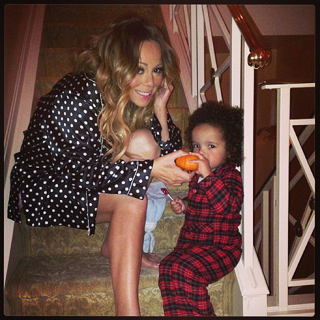 "Mariah Carey shared a photo with her son, Moroccan, while getting prepped for Halloween with the caption, ""Roc's first pumpkin!!!"" Source: Instagram user mariahcarey"