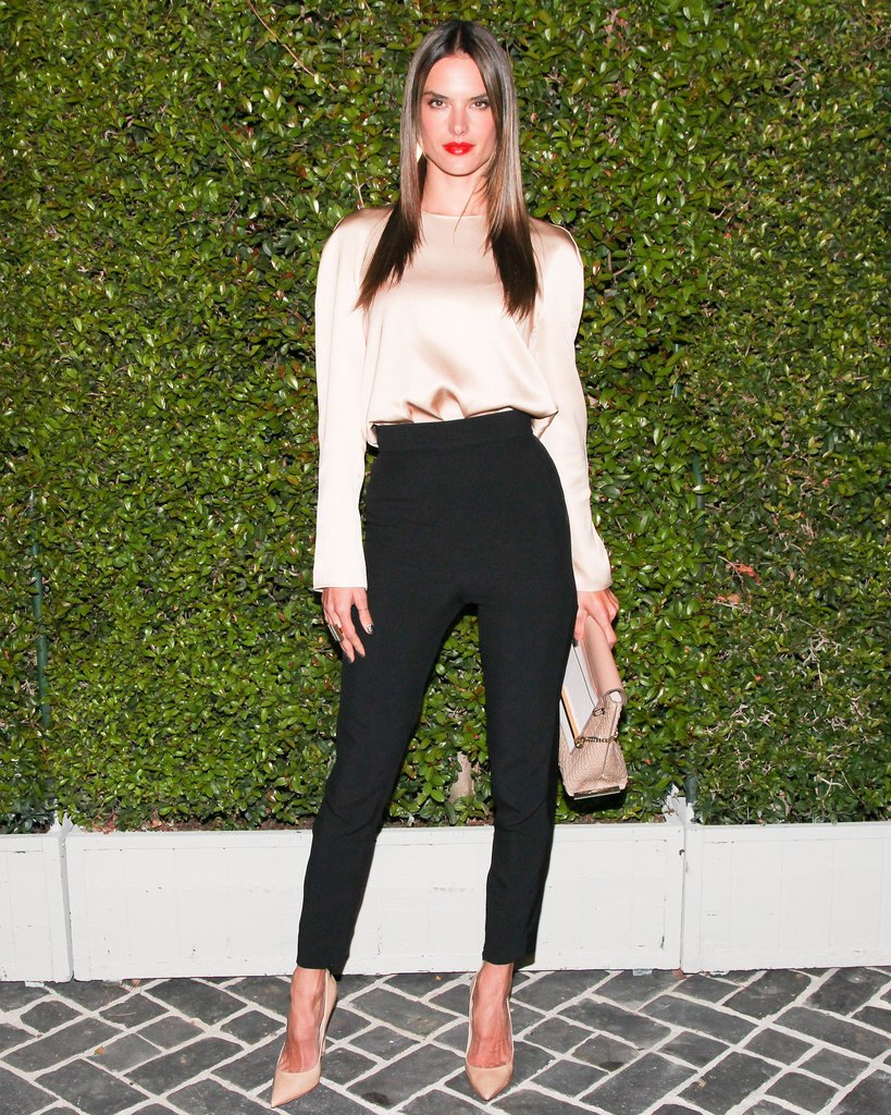 Pairing sleek, high-waisted trousers with a billowy silk blouse and neutral accessories made Alessandra Ambrosio's look at the Chloé fashion show an ultrastylish one.