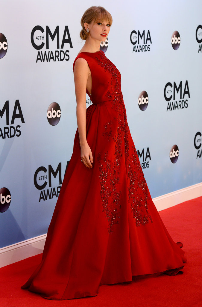 Taylor Swift wore a red ball gown to the CMAs.