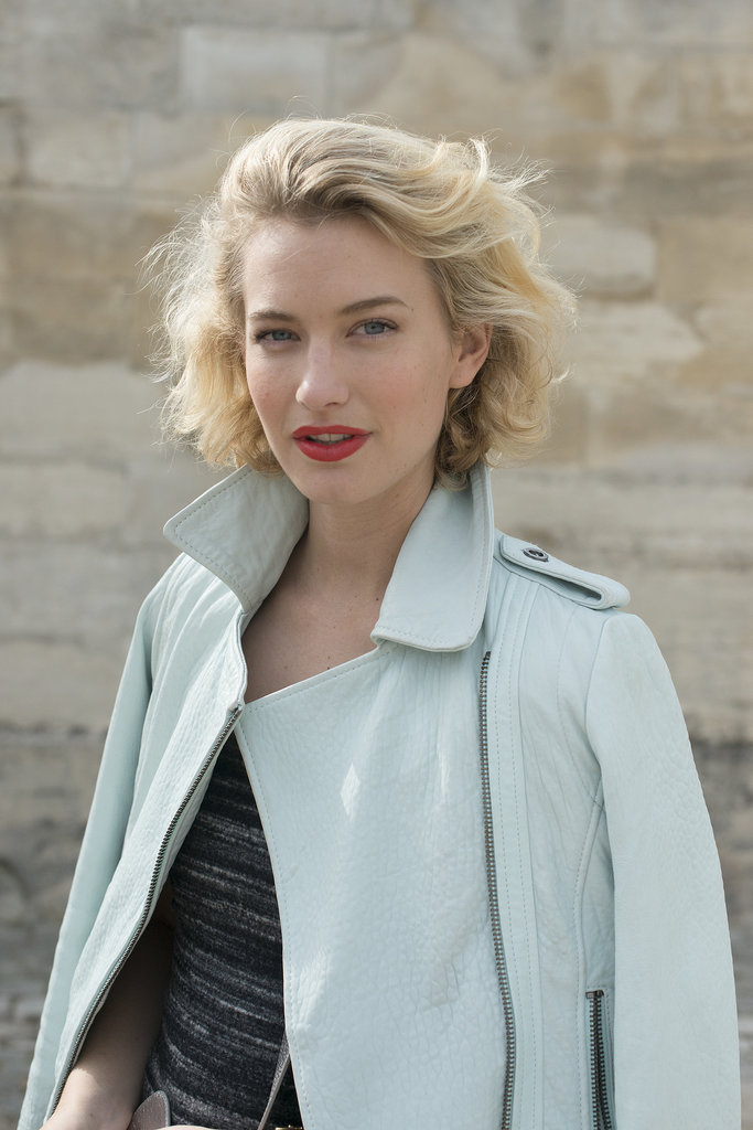 Curl up your bob, add some airy texture, and you have a flirty hairstyle. Red lipstick just completes the look.