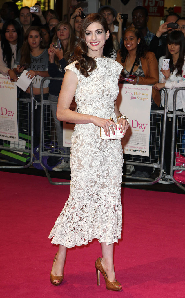 Ladylike glamour in a lace Alexander McQueen creation during a promotional tour for One Day in August 2011.