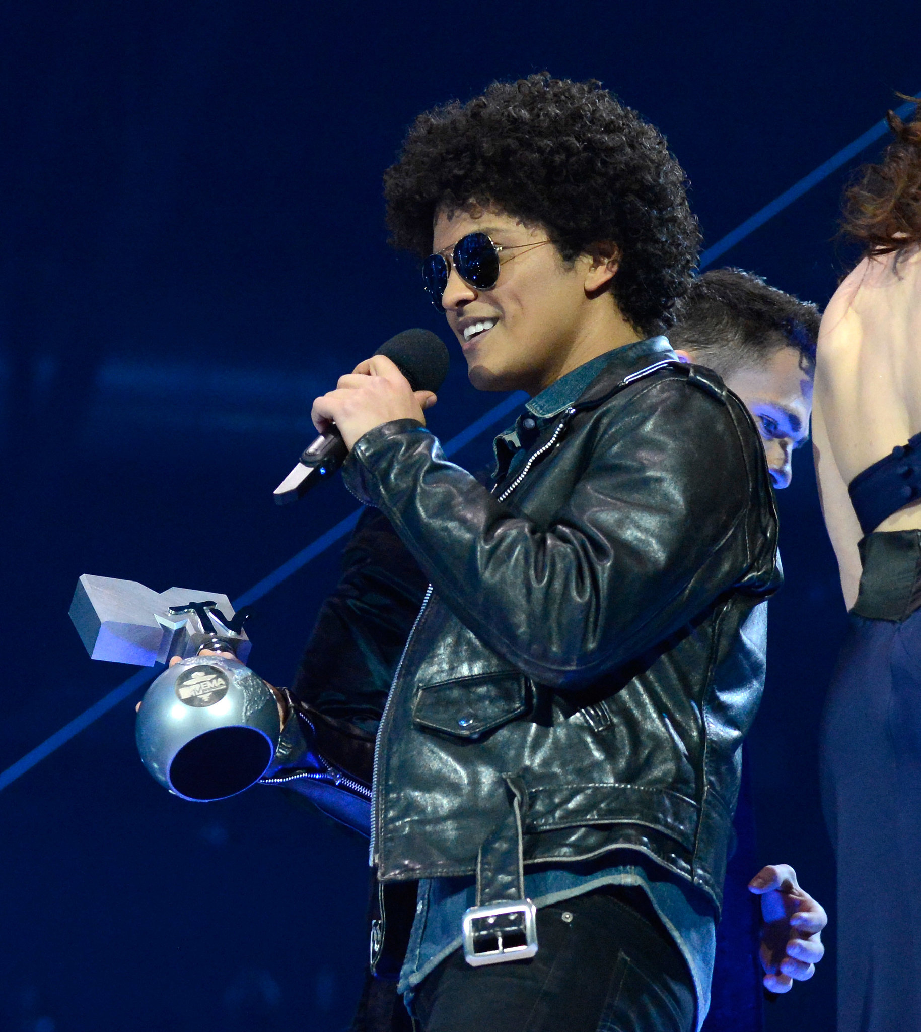 Bruno Mars spoke on stage.