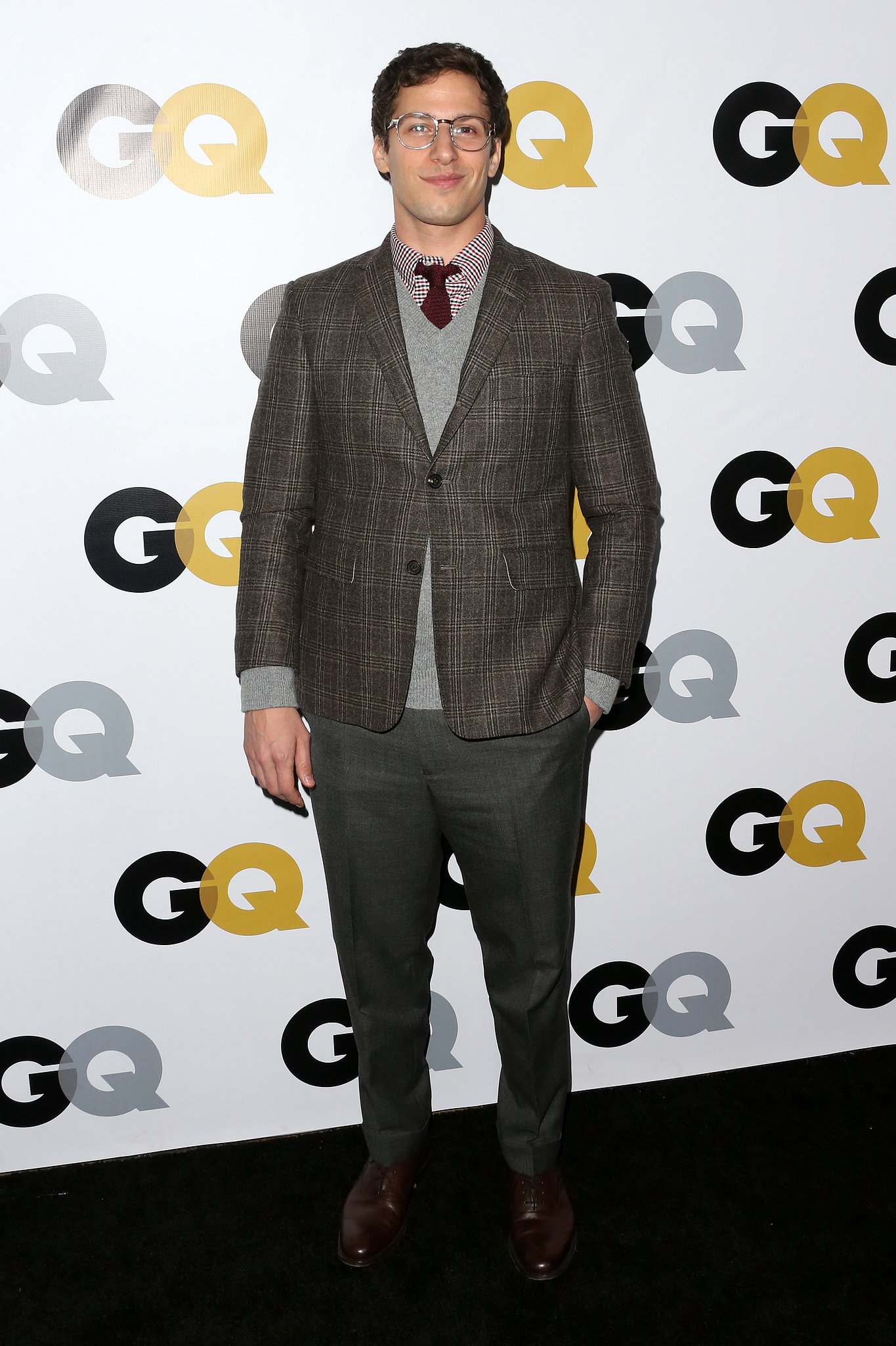 Andy Samberg arrived in a plaid jacket for the GQ Men Of The Year party.
