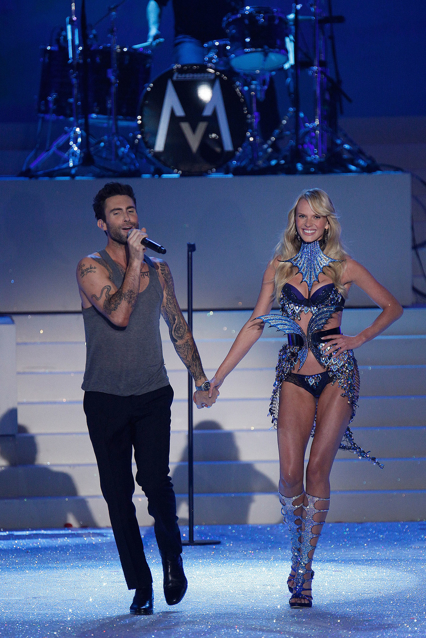 Adam Levine and Anne Vyalitsyna held hands on the runway in 2011.