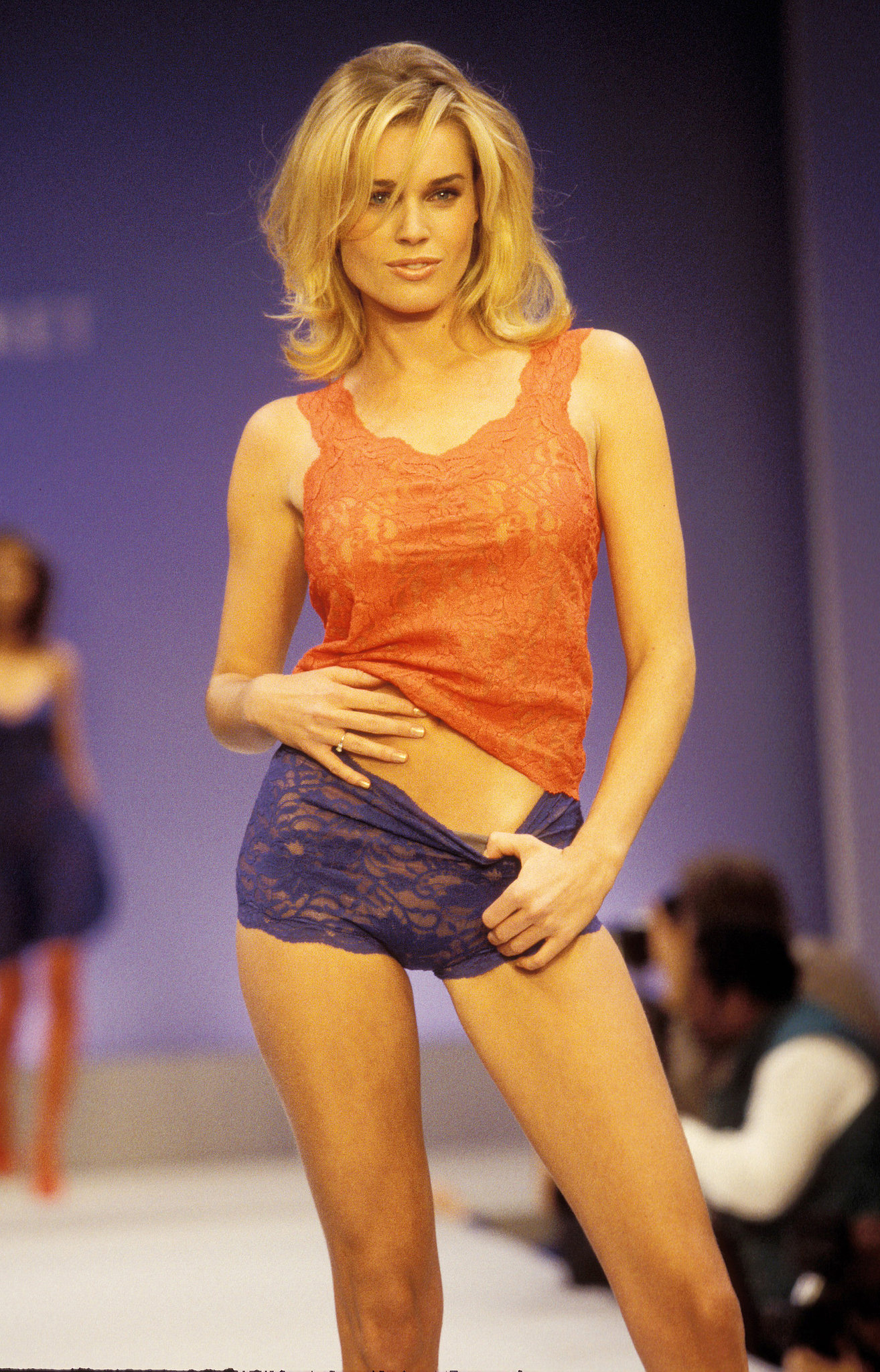 Rebecca Romijn wore a surprisingly modest lace top and boyshorts on the runway in 1997.