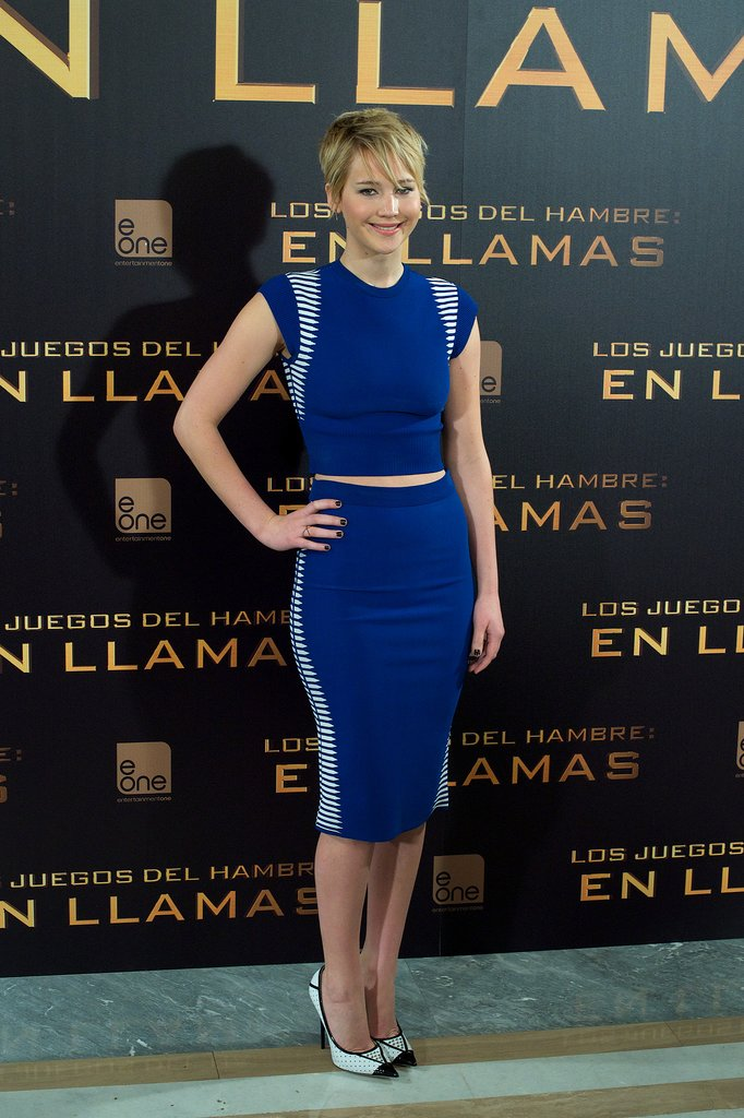 At the Madrid photocall, Lawrence bared a tiny sliver of midsection in a top and skirt by Alexander McQueen.