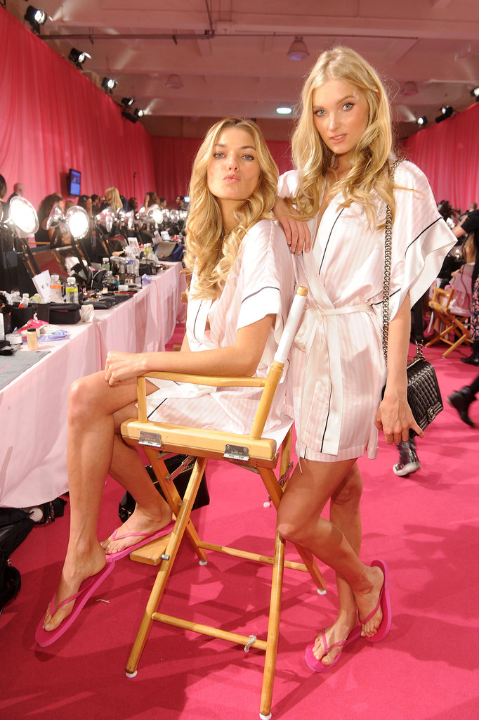 Jessica Hart and Elsa Hosk wore bright pink flip-flops backstage.