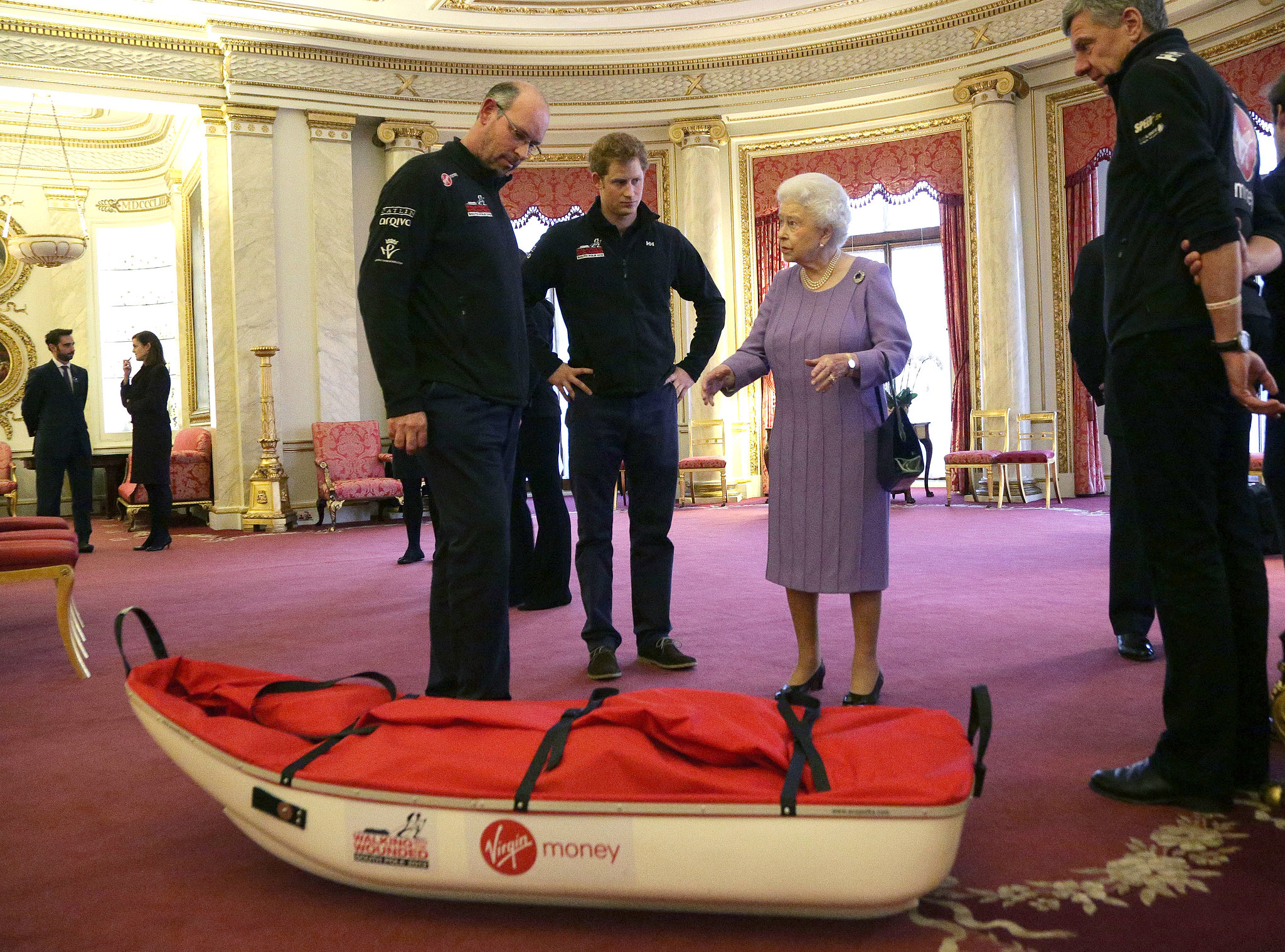 Prince Harry joined his fellow Walking With the Wounded South Pole Allied Challenge trekkers to meet with Queen Elizabeth II in Buckingham Palace on Thursday.