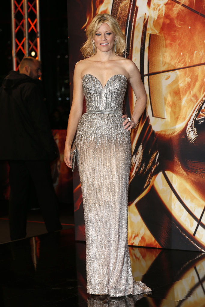 At the Berlin Catching Fire premiere, Elizabeth Banks caught our eye in Elie Saab's showstopping sweetheart gown, which featured metallic silver beading.