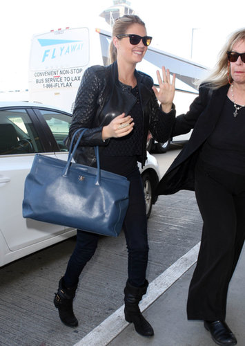 Kate Upton proved that a Chanel tote is the perfect piece to carry you to the gate in style.