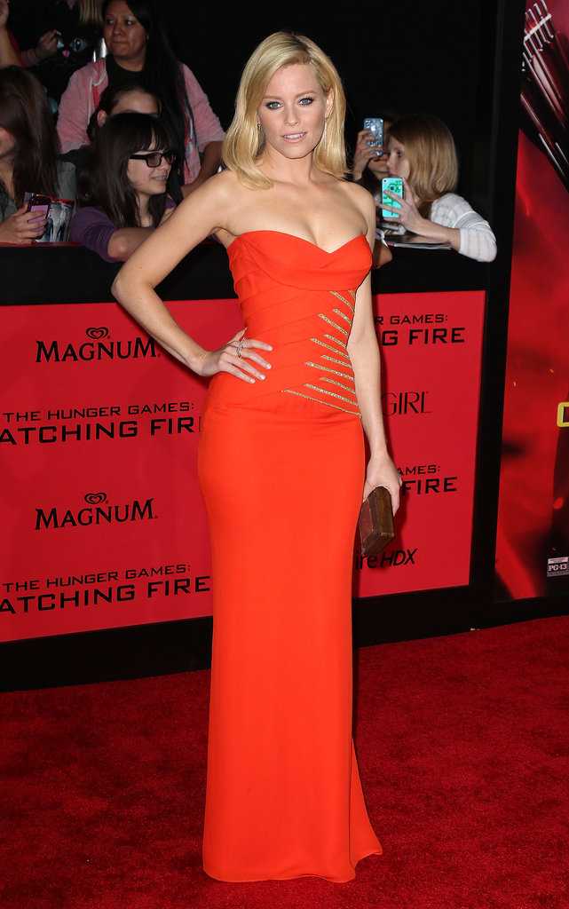 The linear gold detailing on Elizabeth Banks's strapless Versace gown at the Catching Fire LA premiere reminded us of fire —a fitting reference for her film's title and when we're dreaming about the holidays.