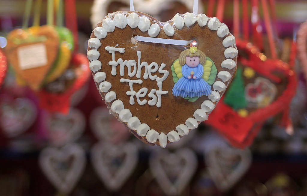 "Cinnamon heart-shaped sweets with ""Happy Holidays"" written on them were for sale at the Rathaus Christmas Market in Vienna."
