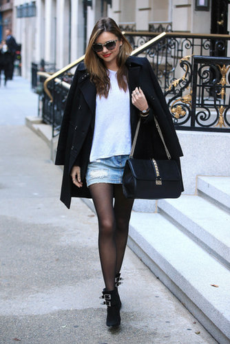 Who says you can't wear a short denim skirt in the Fall? Miranda paired hers with a slouchy tee and a black overcoat. Ankle boots and a chain-strap bag finished her look off perfectly.
