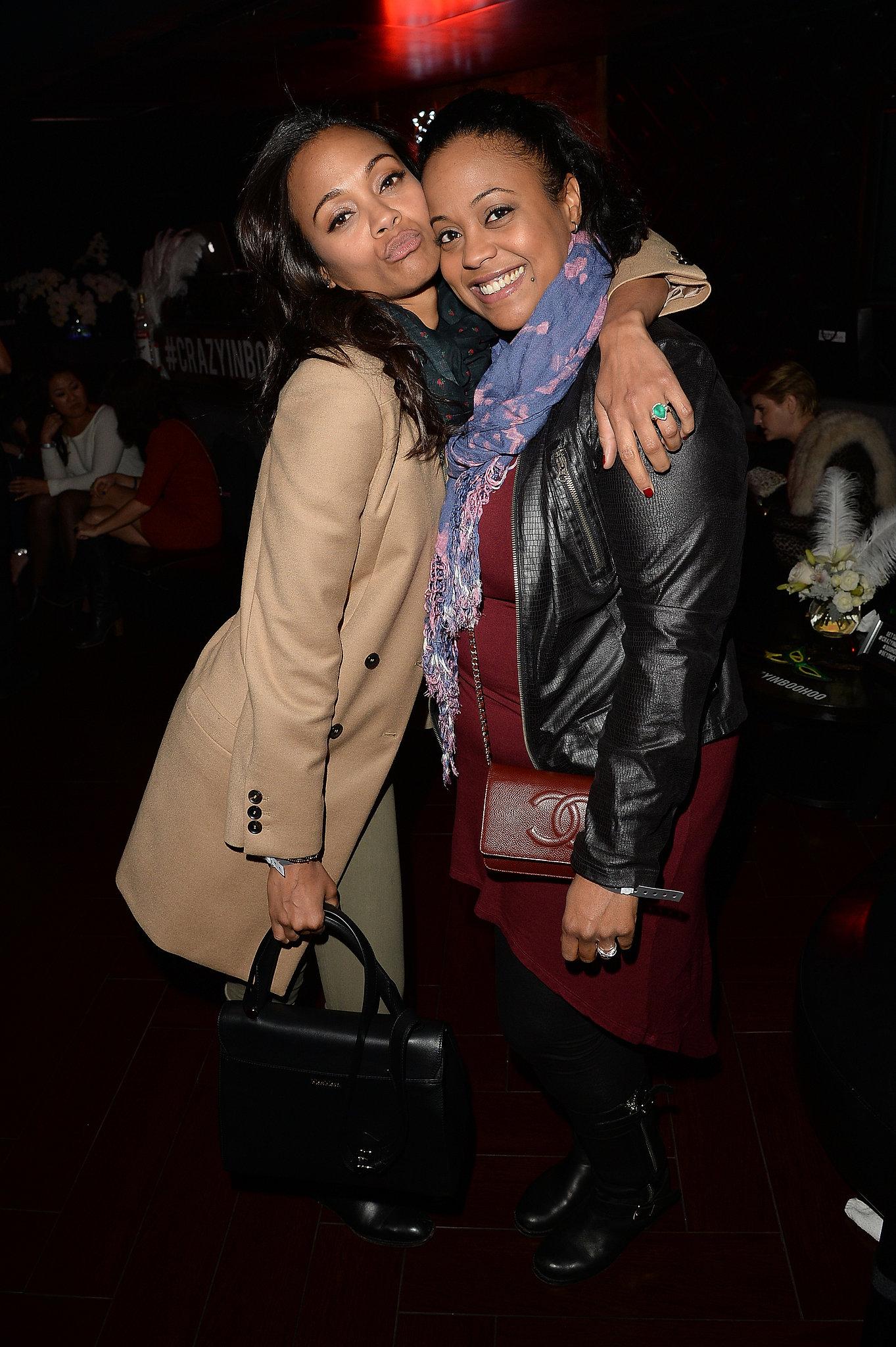 Zoe Saldana planted a kiss on her sister Mariel Saldana.