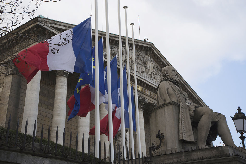 Flags flew at half mast in front of the French National Assembly in Paris.