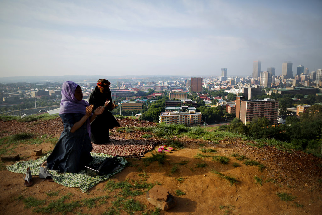 People worshipped on a hill overlooking Johannesburg following Nelson Mandela's passing.