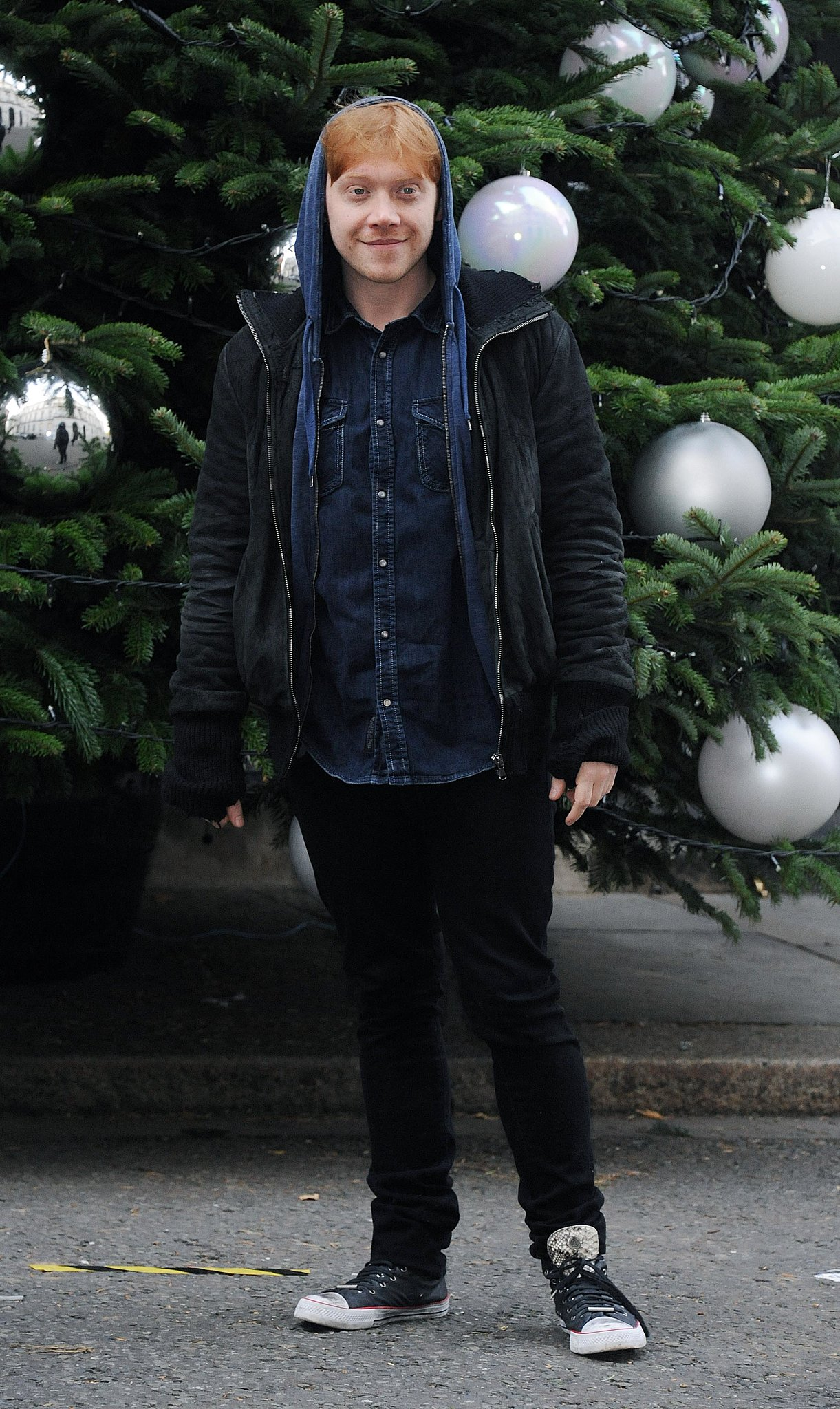 Rupert Grint bundled up for the Downing Street Christmas Party in London, posing in front of a tree that would make Hogwarts proud.