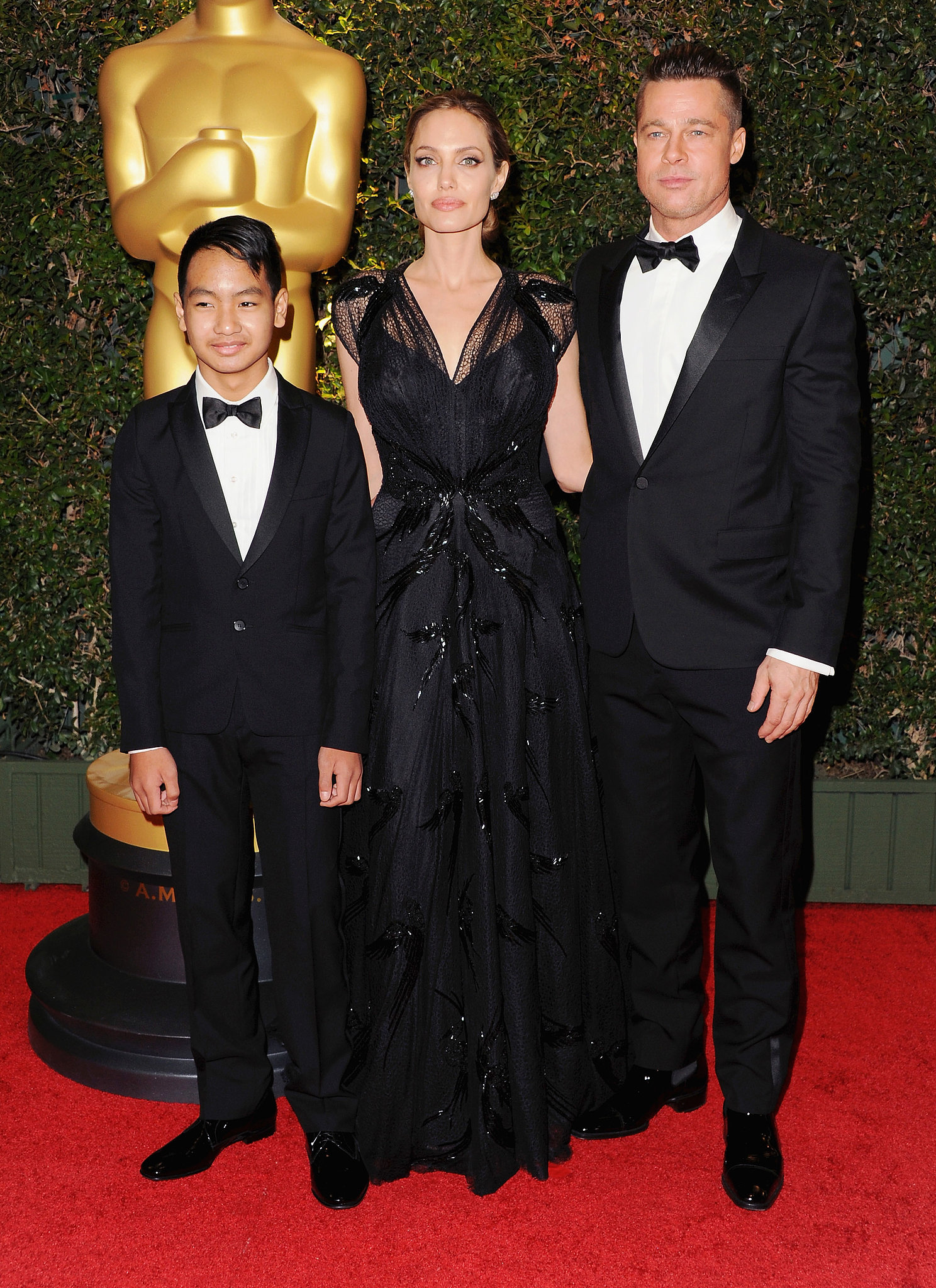 Angelina Jolie walked the Governors Awards red carpet with Brad Pitt and their son Maddox before she was presented with the Jean Hersholt Humanitarian Award.