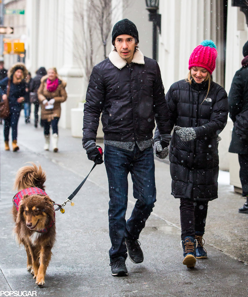 Amanda Seyfried and Justin Long held hands during a snowy stroll with her dog, Finn, in NYC in December 2013.