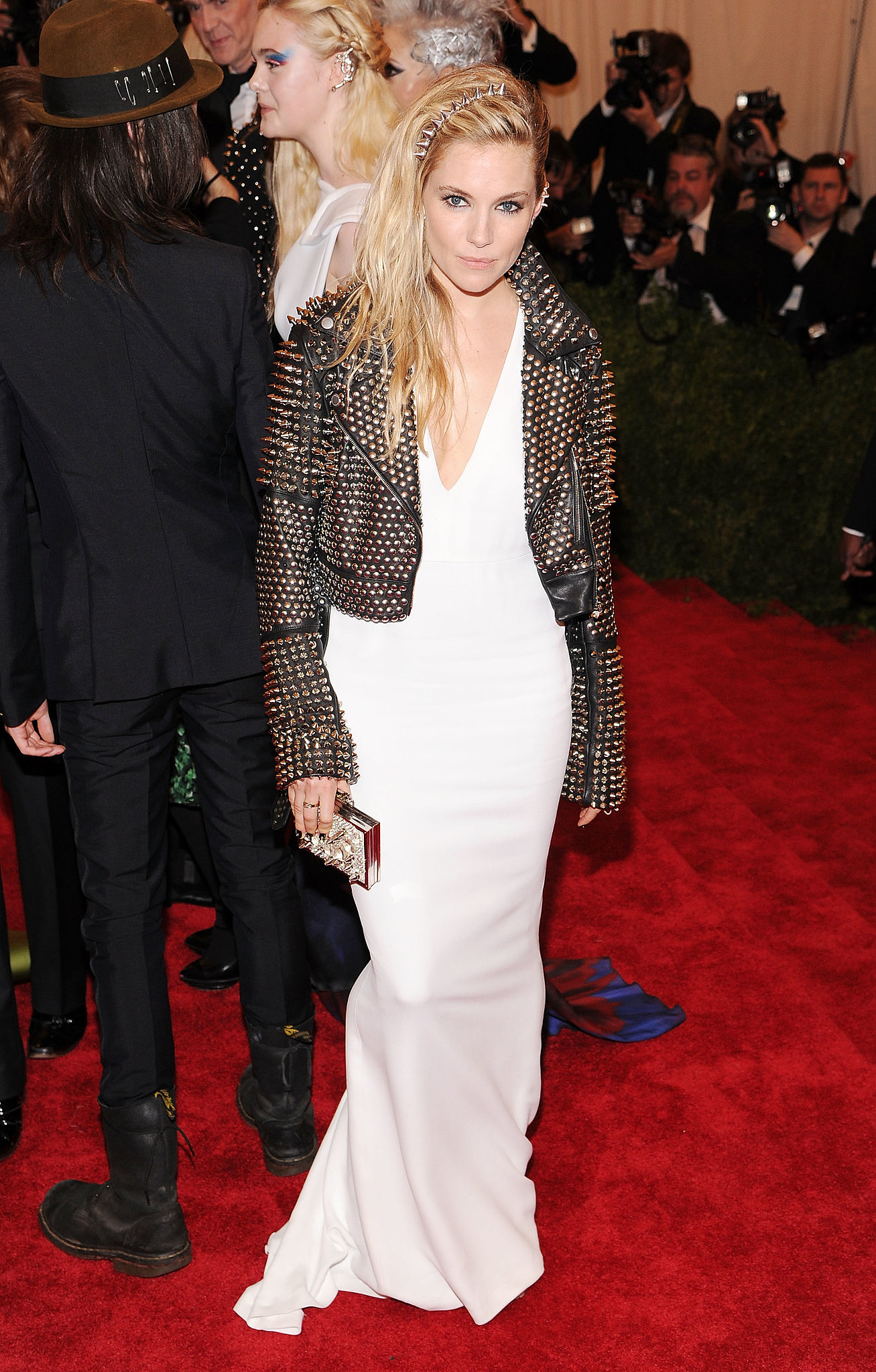 Let's all take a moment to appreciate the punk-princess realness Sienna gave us at the 2013 Met Gala. [silence] The actress decided to contrast her fluid crepe white gown with a black studded leather biker jacket, both by Burberry, and a matching spike