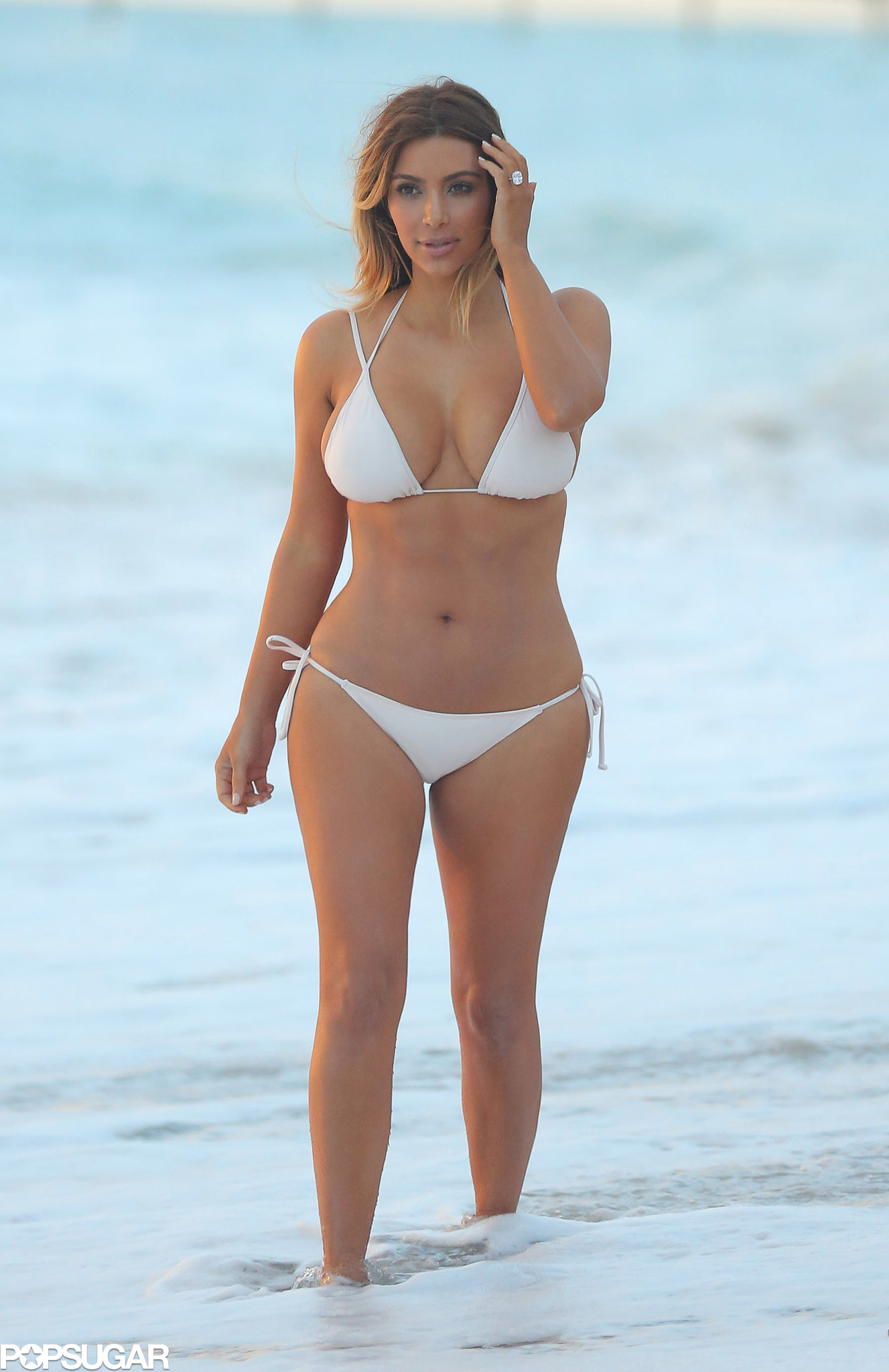 Kim wore a white bikini just six months after giving birth.