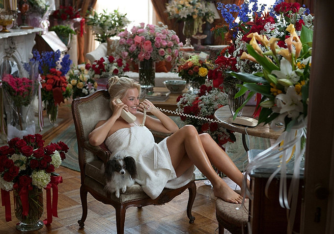 He also romances Naomi with copious bouquets of flowers.