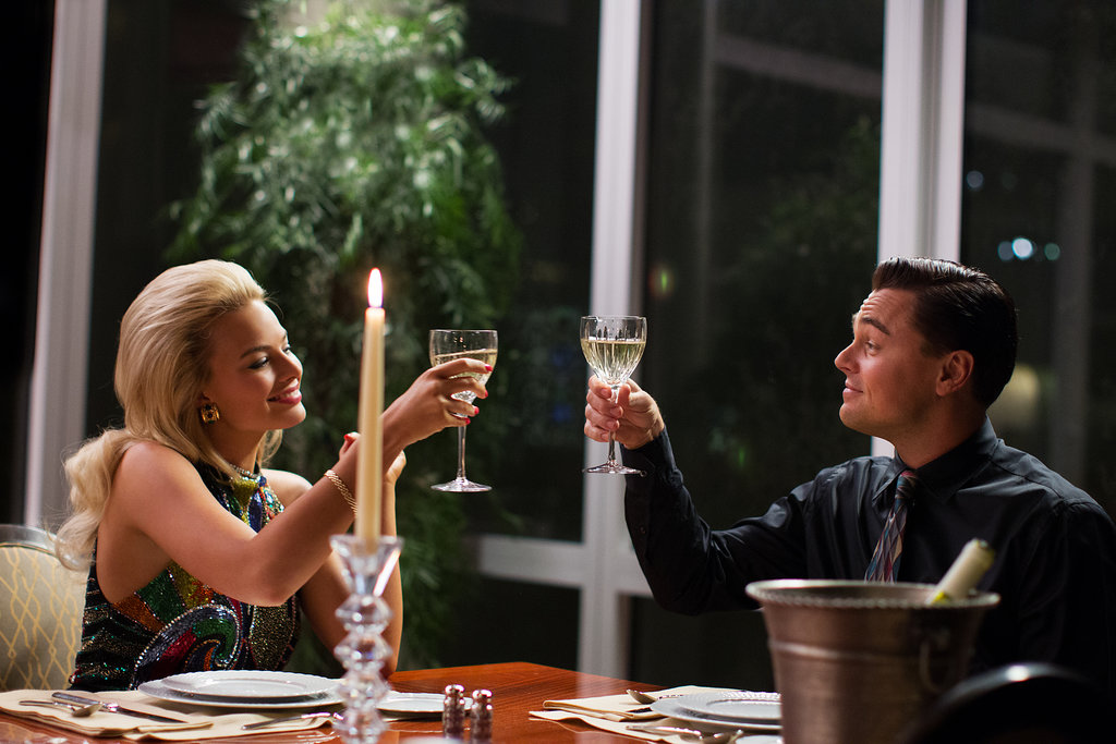 The couple shares a toast.