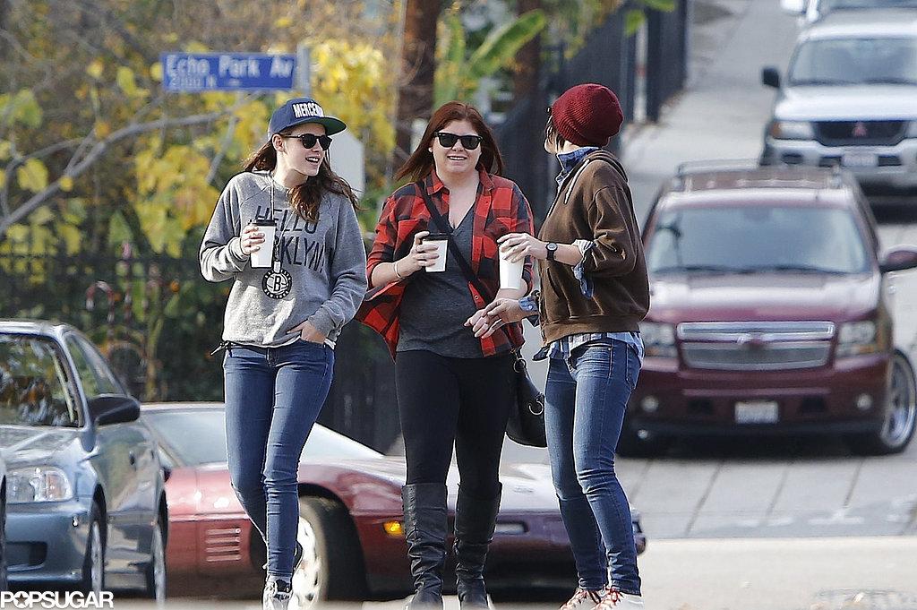 Kristen Stewart held onto a coffee.