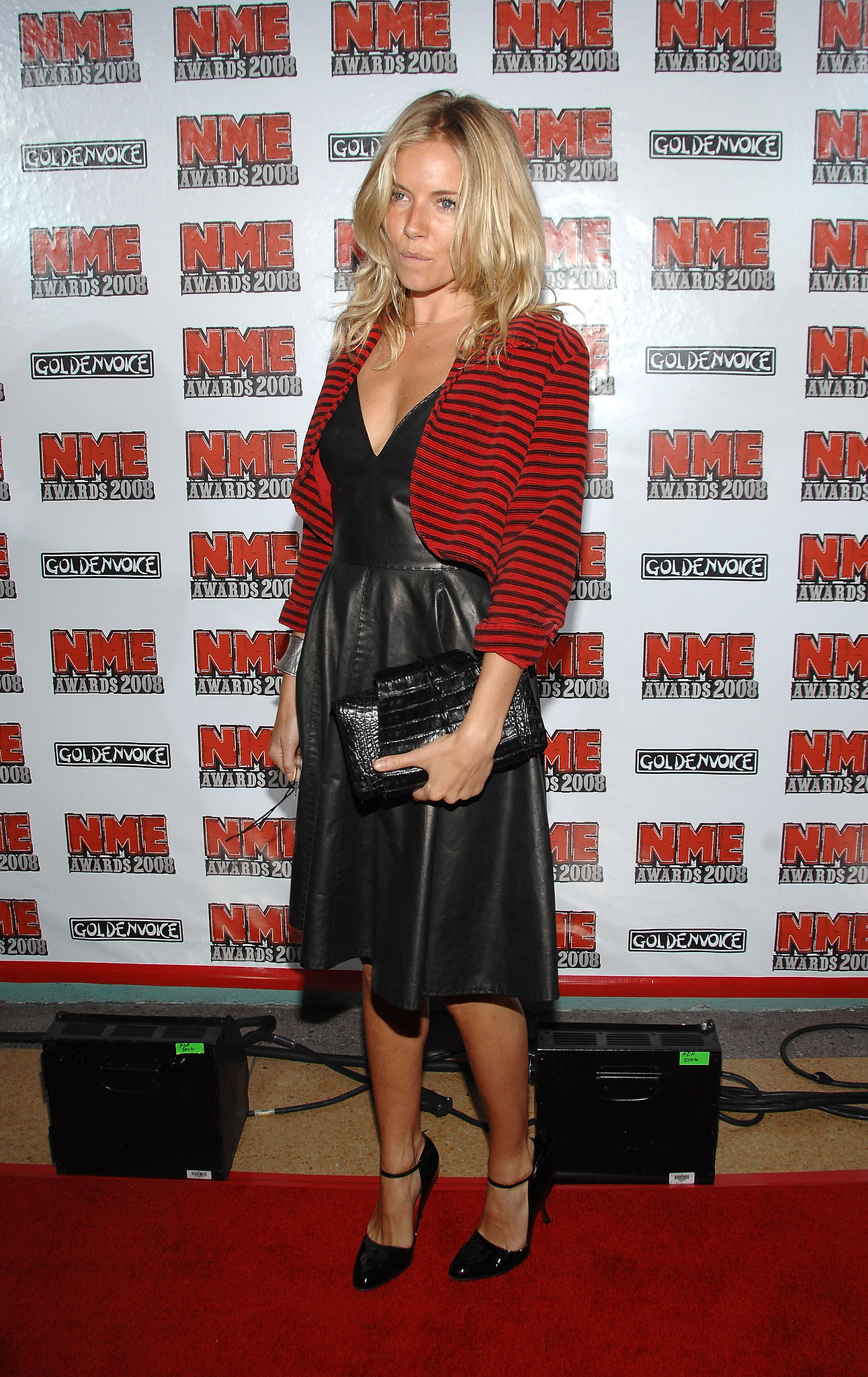 Sienna went for black leather and stripes for a red carpet event in 2008.